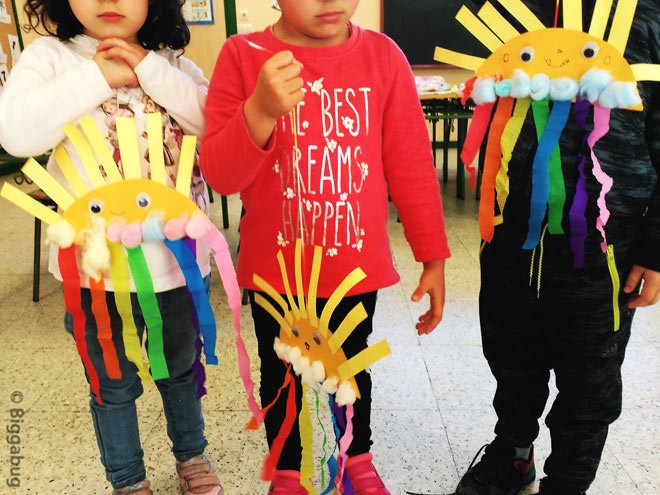 preschoolers showing sun and rainbow craft
