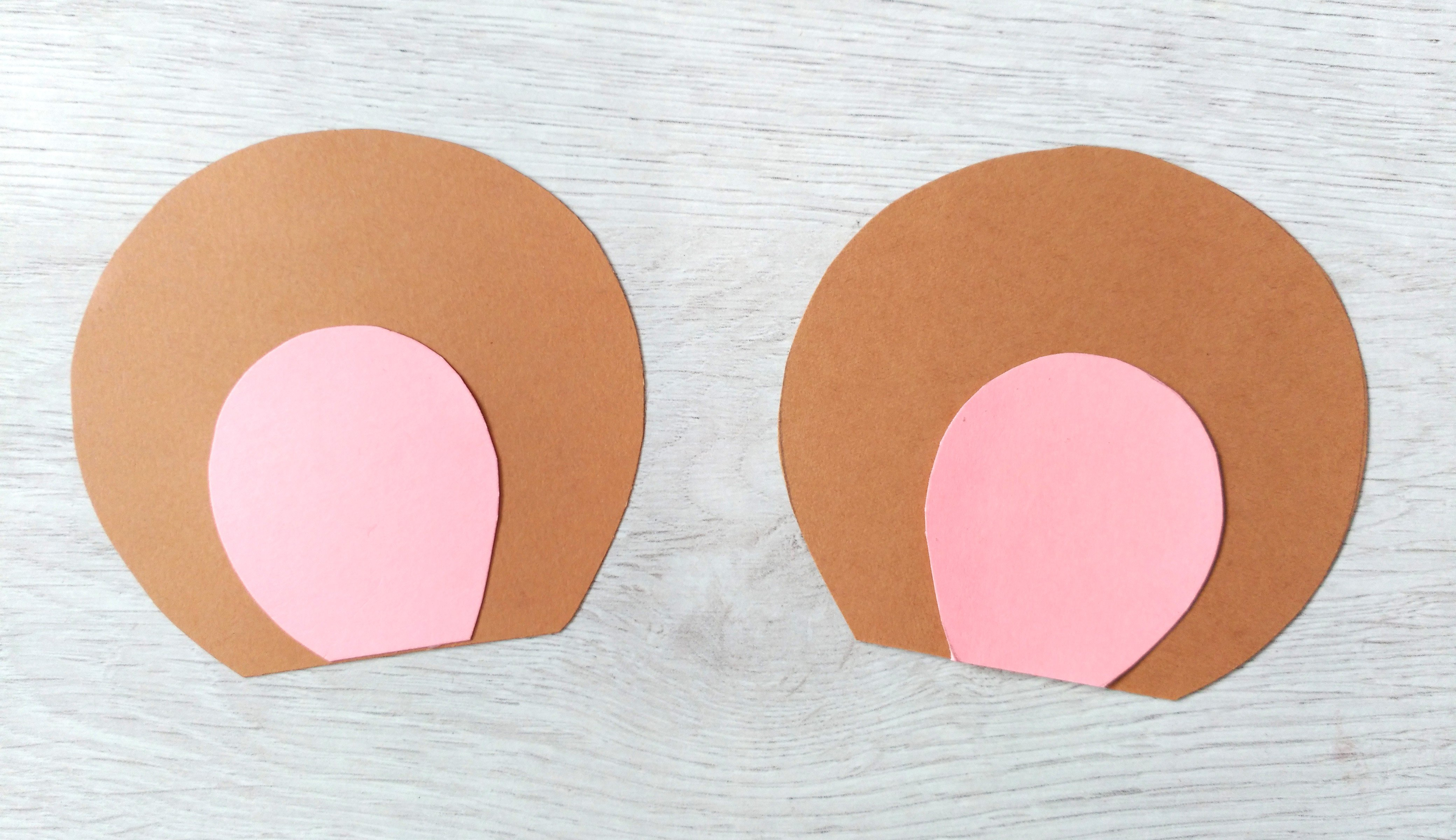 3. If you're using the template version, stick the pink inner ears onto the outer ears.